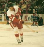 Jamie Pushor leans into a shot while skating during pregame warmups.