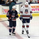 Johnny Gaudreau and James van Riemsdyk get set for the opening faceoff of the 2018 Stars & Stripes Showdown.