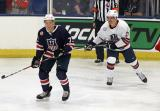 Charlie McAvoy of Team Blue defends against Jack Roslovic of Team White during the 2018 Stars & Stripes Showdown.