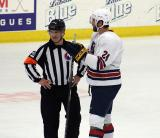 Jarred Tinordi talks with one of the officials during a stop in play in the 2018 Stars & Stripes Showdown.