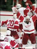 The Red Wings rush onto the ice after winning the Stanley Cup in 1997.