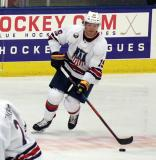 Jake McCabe skates with the puck during the 2018 Stars & Stripes Showdown.