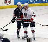 Justin Abdelkader of Team White and J.T. Compher of Team Blue jostle for position on a faceoff during the 2018 Stars & Stripes Showdown.