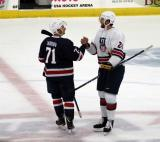 Dylan Larkin of Team Blue and Jarred Tinordi of Team White shake hands after the 2018 Stars & Stripes Showdown.