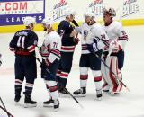 Luke Glendening and Dylan Larkin of Team Blue shake hands with Nick Foligno, Auston Matthews, and Alex Nedeljkovic of Team White after the 2018 Stars & Stripes Showdown.