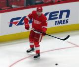 Christoffer Ehn skates near the boards during pre-game warmups before the Red Wings' home opener against the Columbus Blue Jackets.