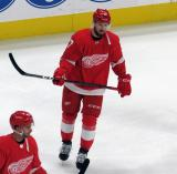 Filip Hronek skates during pre-game warmups before the Red Wings' home opener against the Columbus Blue Jackets.
