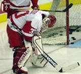 Chris Osgood crouches over at the side of the net before taking the crease during pregame warmups.