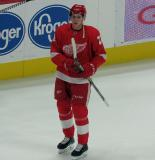 Dennis Cholowski skates during pre-game warmups before the Red Wings' home opener against the Columbus Blue Jackets.