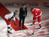 Nick Foligno of the Columbus Blue Jackets takes a ceremonial faceoff against Justin Abdelkader of the Detroit Red Wings, with Henrik Zetterberg dropping the puck, prior to the Red Wings' home opener.