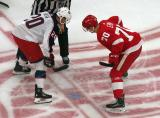 Christoffer Ehn of the Detroit Red Wings gets set for a faceoff against Riley Nash of the Columbus Blue Jackets during the Red Wings' home opener.