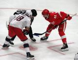 Luke Glendening of the Detroit Red Wings lines up for a faceoff against Pierre-Luc Dubois of the Columbus Blue Jackets during the Red Wings' home opener.