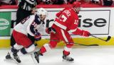 Boone Jenner of the Columbus Blue Jackets persues Filip Hronek of the Detroit Red Wings during the Red Wings' home opener.