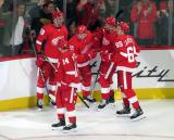 Anthony Mantha, Gustav Nyquist, Dennis Cholowski, Dylan Larkin, and Danny DeKeyser celebrate Cholowski's first career NHL goal during the Red Wings' home opener against the Columbus Blue Jackets.