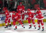 Gustav Nyquist, Dennis Cholowski, Anthony Mantha, Dylan Larkin, and Danny DeKeyser head to the bench for high-fives after Cholowski's first career NHL goal during the Red Wings' home opener against the Columbus Blue Jackets.