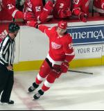 Tyler Bertuzzi skates away from the bench after celebrating a goal during the Red Wings' home opener against the Columbus Blue Jackets.