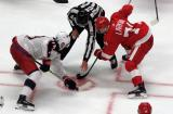 Pierre-Luc Dubois of the Columbus Blue Jackets takes a faceoff against Dylan Larkin of the Detroit Red Wings during the Red Wings' home opener.