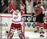 Mike Vernon raises his arms in celebration as the final seconds in the Red Wings' sweep of the Flyers run off the clock.