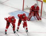 Anthony Mantha, Dennis Cholowski, and Jimmy Howard get set for a faceoff during the Red Wings' home opener against the Columbus Blue Jackets.