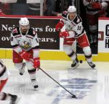 Axel Holmstrom and Turner Elson step onto the ice for pre-game warmups before a game between the Grand Rapids Griffins and the Chicago Wolves.