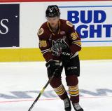 Reid Duke of the Chicago Wolves handles a puck during pre-game warmups before a game between the Wolves and the Grand Rapids Griffins.