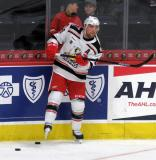 Chris Terry passes a puck from near the boards during pre-game warmups before a game between the Grand Rapids Griffins and the Chicago Wolves.