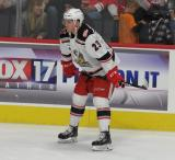 Dominic Turgeon crouches near the boards during pre-game warmups before a game between the Grand Rapids Griffins and the Chicago Wolves.