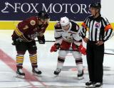 Daniel Carr of the Chicago Wolves lines up next to Chris Terry of the Grand Rapids Griffins on a faceoff in a game between the Griffins and Wolves.