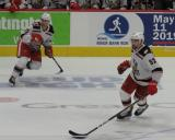 Turner Elson and Dylan McIlrath skate in the neutral zone during a game between the Grand Rapids Griffins and the Chicago Wolves.