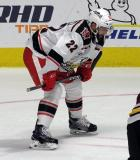 Wade Megan gets set for a faceoff during a game between the Grand Rapids Griffins and the Chicago Wolves.
