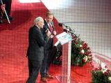Ken Daniels and Mickey Redmond speak during Red Kelly's jersey retirement ceremony.