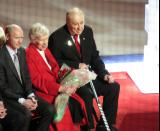 Red Kelly sits during the ceremony to retire his jersey number.