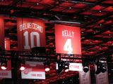 The banner for Red Kelly's retired jersey number joins the previous seven retired numbers in the Little Caesars Arena rafters.