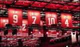 The banners for the Red Wings first eight retired numbers in the Little Caesars Arena rafters, with Red Kelly's number four having just been raised.