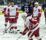 Dan Cleary, Robert Lang and Pavel Datsyuk watch Kirk Maltby skate during pregame warmups.