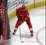 Andreas Athanasiou skates near the boards during pre-game warmups, wearing Red Kelly's #4 on the night of its retirement.