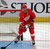 Luke Glendening clears pucks out of the net during pre-game warmups, wearing Red Kelly's #4 on the night of its retirement.