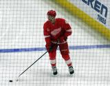 Nick Jensen skates near the blue line during pre-game warmups, wearing Red Kelly's #4 on the night of its retirement.