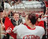 Steve Yzerman lifts the Stanley Cup with Red Wings owner Mike Ilitch.