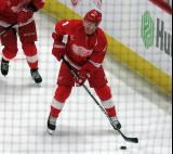 Gustav Nyquist skates near the boards during pre-game warmups, wearing Red Kelly's #4 on the night of its retirement.