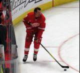 Danny DeKeyser skates near the boards during pre-game warmups, wearing Red Kelly's #4 on the night of its retirement.