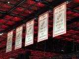 The banners for the Red Wings' 1955, 1997, 1998, 2002, and 2008 Stanley Cup Championships in the Little Caesars Arena rafters.
