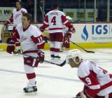 Dan Cleary skates near the blue line while Steve Yzerman crouches in the foreground and Nicklas Lidstrom and Jamie Rivers stand in the neutral zone during pregame warmups.