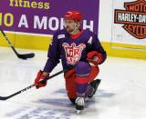 Dylan McIlrath of the Grand Rapids Griffins kneels on the ice during pre-game warmups before the Griffins' annual Purple Game.