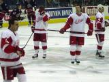 Jamie Rivers skates during pregame warmups while Dan Cleary, Robert Lang and Chris Chelios stand at center ice.