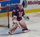Harri Sateri of the Grand Rapids Griffins gets set in his crease during pre-game warmups before the Griffins' annual Purple Game.