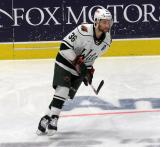 Colton Beck of the Iowa Wild skates near the boards during pre-game warmups before a game against the Grand Rapids Griffins.