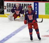 Libor Sulak of the Grand Rapids Griffins skates in the neutral zone, with goalie Patrik Rybar stretching near the boards, during pre-game warmups before the Griffins' annual Purple Game.