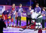 Brian Lashoff of the Grand Rapids Griffins and Cal O'Reilly of the Iowa Wild take part in a ceremonial faceoff prior to the Griffins' annual Purple Game.