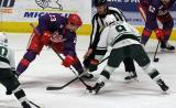 Dominic Turgeon of the Grand Rapids Griffins takes a faceoff against Cal O'Reilly of the Iowa Wild during the Griffins' annual Purple Game.